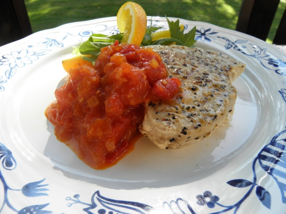 Tuna steak with savory spicy tomato & orange dressing.